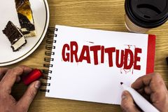 Conceptual hand writing showing Gratitude. Business photo showcasing Quality of being thankful Appreciation Thankfulness Acknowled. Ge written by Man Notebook Royalty Free Stock Photos