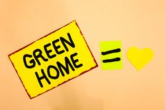 Conceptual hand writing showing Green Home. Business photo text An area filled with plants and trees where you can relax Yellow pa stock photos