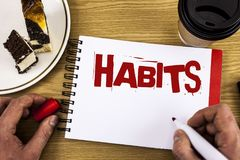 Conceptual hand writing showing Habits. Business photo showcasing Regular tendency or practice Routine Usual Manners Behavior Patt. Ern written by Man Notebook Royalty Free Stock Photo