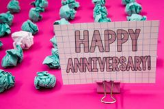 Conceptual hand writing showing Happy Anniversary Motivational Call. Business photo showcasing Annual Special Milestone Commemorat. Ion Paperclip with pink stock photography