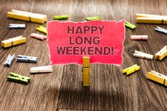 Conceptual hand writing showing Happy Long Weekend. Business photo text wishing someone happy vacation Travel to holiday Clips spr. Ead woody table learn study Royalty Free Stock Photo