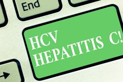 Conceptual hand writing showing Hcv Hepatitis C. Business photo showcasing Liver disease caused by a virus severe chronic illness. Keyboard key Intention to stock photo