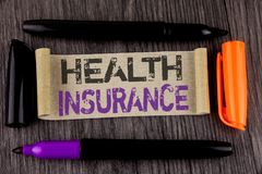 Conceptual hand writing showing Health Insurance. Business photo text Health insurance information coverage healthcare provider wr. Itten Cardboard Paper the stock photography