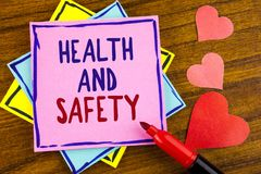 Conceptual hand writing showing Health And Safety. Business photo text being in good condition harmless Workouts Healthy food writ. Ten Sticky note paper wooden Royalty Free Stock Photography