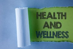 Conceptual hand writing showing Health And Wellness. Business photo text being in good shape Healthy food workout drink water writ. Ten under Tear Folded paper Royalty Free Stock Photography