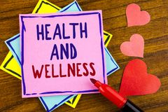 Conceptual hand writing showing Health And Wellness. Business photo text being in good shape Healthy food workout drink water writ. Ten Sticky note paper wooden Stock Images