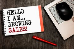 Conceptual hand writing showing Hello I Am... Growing Sales. Business photo showcasing Making more money Selling larger quantities. Bluetooth mouse on keyboard royalty free stock photography