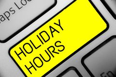 Conceptual hand writing showing Holiday Hours. Business photo text Schedule 24 or 7 Half Day Today Last Minute Late Closing Keyboa. Rd yellow key computer royalty free stock photos