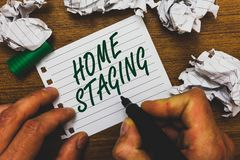 Conceptual hand writing showing Home Staging. Business photo text Act of preparing a private residence for sale in the market Man. Holding marker notebook page royalty free stock image