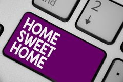 Conceptual hand writing showing Home Sweet Home. Business photo showcasing In house finally Comfortable feeling Relaxed Family tim. E Keyboard purple key royalty free stock photos