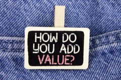 Conceptual hand writing showing How Do You Add Value Question. Business photo text Bring business progress contribute earn written. Wood Piece the Jeans Stock Image