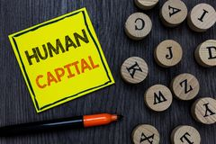 Conceptual hand writing showing Human Capital. Business photo showcasing Intangible Collective Resources Competence. Capital Education Yellow paper circle stock photo