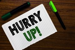 Conceptual hand writing showing Hurry Up. Business photo text To move,proceed,or act,with haste at the best of your speed Notebook. Paper markers wooden stock photos