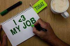 Conceptual hand writing showing I love My Job. Business photo showcasing telling someone that you admire your current profession M. An holding marker notebook Royalty Free Stock Photo