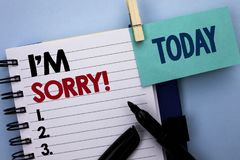 Conceptual hand writing showing I m Sorry. Business photo text Apologize Conscience Feel Regretful Apologetic Repentant Sorrowful. Written Notebook Book plain Royalty Free Stock Image
