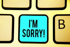 Conceptual hand writing showing I am Sorry. Business photo showcasing To ask for forgiveness to someone you unintensionaly hurt Ke. Yboard blue key computer royalty free stock image