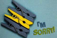 Conceptual hand writing showing I am Sorry. Business photo text To ask for forgiveness to someone you unintensionaly hurt Gray yel. Low vintage clothespins clear royalty free stock image