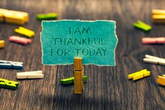 Conceptual hand writing showing I Am Thankful For Today. Business photo showcasing Grateful about living one more day Philosophy P. Aperclip retain blue stock photography