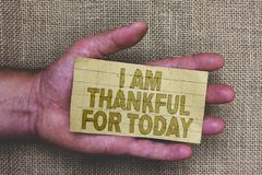 Conceptual hand writing showing I Am Thankful For Today. Business photo showcasing Grateful about living one more day Philosophy T. Hick gray paper with words stock image