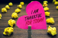 Conceptual hand writing showing I Am Thankful For Today. Business photo text Grateful about living one more day Philosophy Papercl. Ip hold pink written heart stock images