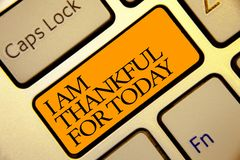 Conceptual hand writing showing I Am Thankful For Today. Business photo text Grateful about living one more day Philosophy Golden. Grey computer keyboard with royalty free stock photos