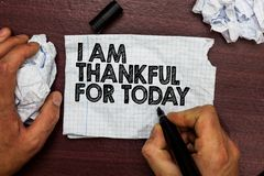 Conceptual hand writing showing I Am Thankful For Today. Business photo text Grateful about living one more day Philosophy Hand ho. Ld pen sketch word on torn royalty free stock photography