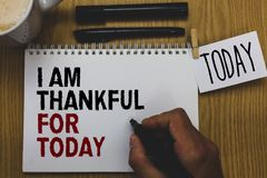 Conceptual hand writing showing I Am Thankful For Today. Business photo text Grateful about living one more day Philosophy Written. On paper hand hold pen royalty free stock photography
