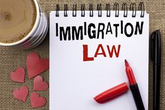 Conceptual hand writing showing Immigration Law. Business photo showcasing National Regulations for immigrants Deportation rules w. Ritten Notebook Book the jute royalty free stock photo