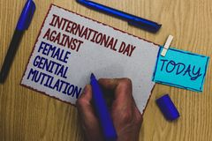 Conceptual hand writing showing International Day Against Female Genital Mutilation. Business photo text awareness day February Ma. N holding marker paper Stock Image