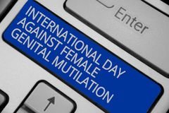 Conceptual hand writing showing International Day Against Female Genital Mutilation. Business photo text awareness day February Ke. Yboard blue key create Stock Images