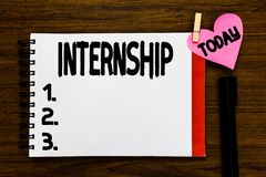 Conceptual hand writing showing Internship. Business photo text Student Trainee working on organization to gain. Experience Open notebook page markers holding royalty free stock photography