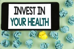 Conceptual hand writing showing Invest In Your Health. Business photo text Spend money in personal healthcare Preventive Tests wri. Tten Mobile Phone Screen the royalty free stock image