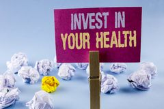 Conceptual hand writing showing Invest In Your Health. Business photo text Spend money in personal healthcare Preventive Tests wri. Tten Sticky Note Paper plain stock photo