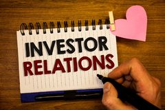 Conceptual hand writing showing Investor Relations. Business photo text Finance Investment Relationship Negotiate Shareholder Huma. N hand retain black pen stock photography
