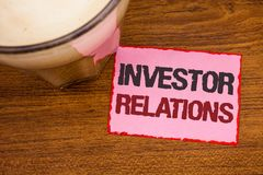 Conceptual hand writing showing Investor Relations. Business photo text Finance Investment Relationship Negotiate Shareholder Wood. En desktop red lined pink stock photography