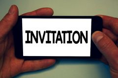 Conceptual hand writing showing Invitation. Business photo showcasing Written or verbal request someone to go somewhere or do some. Thing Man hold holding cell royalty free stock image