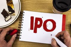 Conceptual hand writing showing Ipo. Business photo showcasing Initial Public Offering First time stock of company is offered to p. Ublic written by Man Notebook Royalty Free Stock Photography