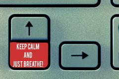 Conceptual hand writing showing Keep Calm And Just Breathe. Business photo text Take a break to overcome everyday. Difficulties Keyboard Intention to create royalty free illustration