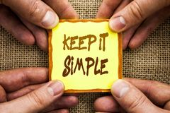 Conceptual hand writing showing Keep It Simple. Business photo showcasing Simplicity Easy Strategy Approach Principle written on S. Conceptual hand writing Royalty Free Stock Photo