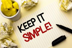Conceptual hand writing showing Keep It Simple Motivational Call. Business photo showcasing Simplify Things Easy Clear Concise Ide. As written Notebook Paper the Stock Photos