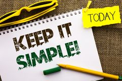 Conceptual hand writing showing Keep It Simple Motivational Call. Business photo showcasing Simplify Things Easy Clear Concise Ide. As written Notebooke Book the Royalty Free Stock Image