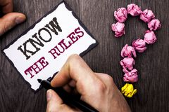 Conceptual hand writing showing Know The Rules. Business photo text Be aware of the Laws Regulations Protocols Procedures written. By Man Sticky Note Holding royalty free stock photo