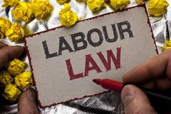 Conceptual hand writing showing Labour Law. Business photo showcasing Employment Rules Worker Rights Obligations Legislation Union. Written by Man Holding Stock Photos