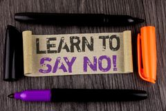 Conceptual hand writing showing Learn To Say No Motivational Call. Business photo text Encouragement advice tips morality values w. Ritten Cardboard Paper the stock photo