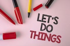 Conceptual hand writing showing Let Us Do Things. Business photo text Try something new find happiness mastering it by practice wr. Itten plain Pink background stock photo