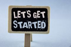 Conceptual hand writing showing Lets Get Started. Business photo showcasing beginning time motivational quote Inspiration encourag. E written Wooden Notice Board stock photography