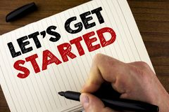 Conceptual hand writing showing Lets Get Started. Business photo showcasing beginning time motivational quote Inspiration encourag. E written by Man Notebook stock images