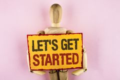 Conceptual hand writing showing Lets Get Started. Business photo text beginning time motivational quote Inspiration encourage writ. Ten Sticky note paper Wooden stock image