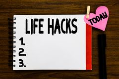Conceptual hand writing showing Life Hacks. Business photo text Strategy technique to analysisage daily activities more. Efficiently Open notebook page markers royalty free stock image