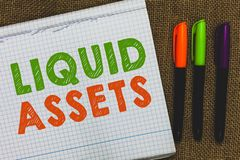 Conceptual hand writing showing Liquid Assets. Business photo text Cash and Bank Balances Market Liquidity Deferred Stock Open not stock photography